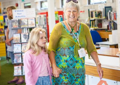 Minchinhampton Community Library Volunteer with a library user