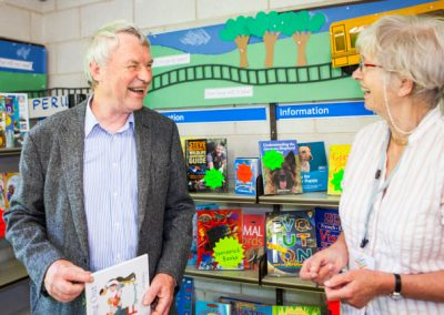 Minchinhampton Community Library Volunteer with a member of the community